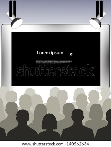 public in a hall in front of the screen