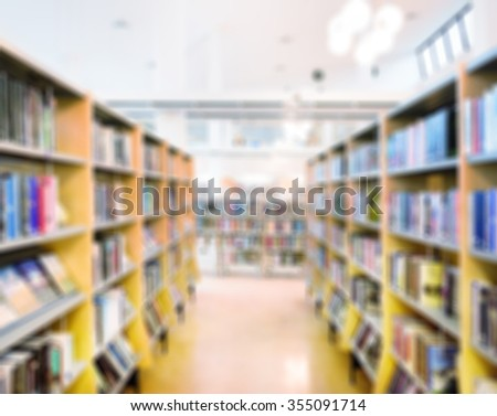 Public library bookshelf, out of focus - stock photo