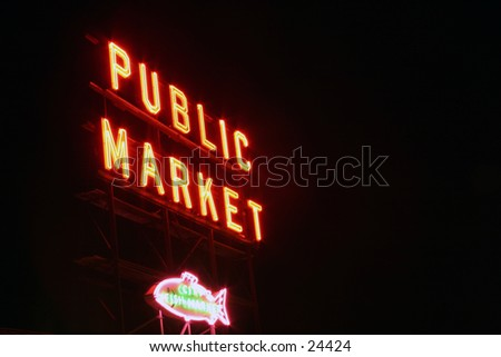 public market neon sign taken with a short time laps (bulb exposure) for effect - stock photo