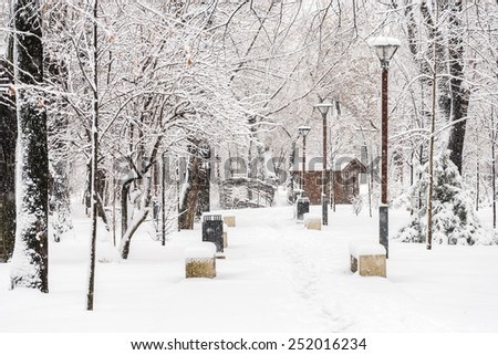 Public Park During Heavy Snowfall In Winter In Bucharest City, Romania. - stock photo