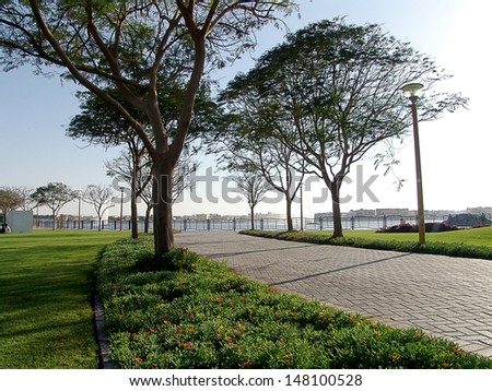 public park with pond and fountain - stock photo