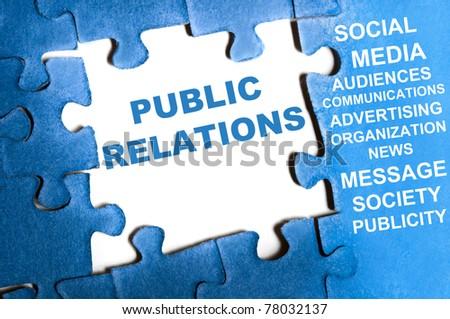 Public relations blue puzzle pieces assembled - stock photo