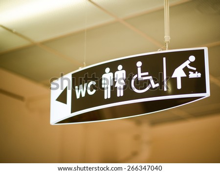 Public restroom sign - stock photo