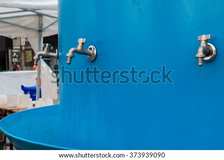 Public Steel Turncock over Blue Backround in City Streets - stock photo