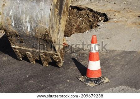 Public street day maintenance works, excavator work - stock photo