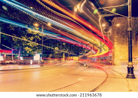 public transport metropolis, traffic and blurry lights tram at night, Istanbul, Turkey - stock photo