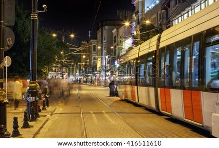 Public transport metropolis, traffic and lights of tram at night.  - stock photo