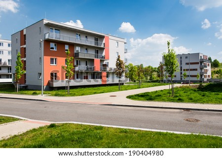 Public view of newly built blocks of flats in the green park - stock photo