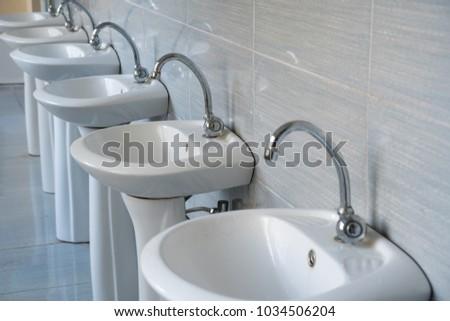 stainless steel bathroom fixtures. Public Water Taps In The School\u0027s Toilet. Stainless Steel Bathroom Fixtures