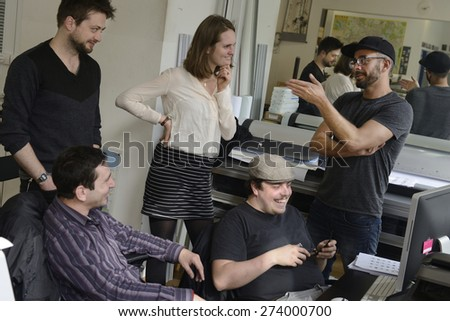 Publisher advertising agency owner work with team on a creative project. - stock photo
