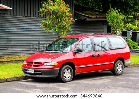 PUCON, CHILE - NOVEMBER 20, 2015: Motor car Chrysler Caravan at the town street. - stock photo