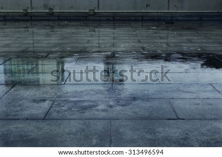 Puddle of Water in Rainy Day. - stock photo
