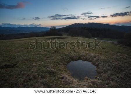 puddle on field during sunset near Freiburg  - stock photo