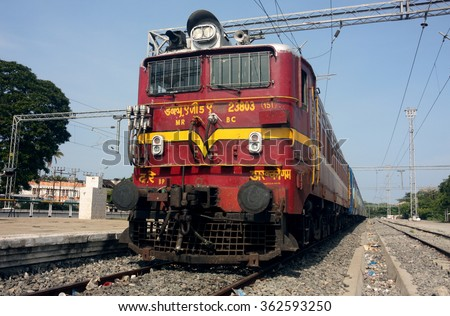 PUDUCHERRY, INDIA - CIRCA MARCH 2014: Indian train pulled by an electric locomotive at Puducherry (Pondicherry) station in eastern India - stock photo