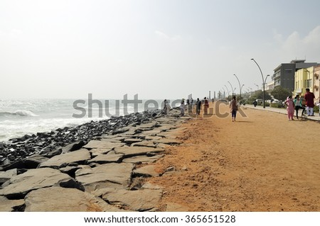PUDUCHERRY, INDIA - JANUARY 2: people walk near the sea on January 2, 2014 in Puducherry.