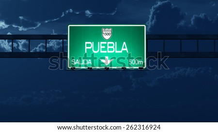 Puebla Mexico Highway Road Sign at Night  - stock photo