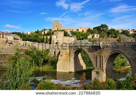 Puente de San Martin bridge over the Tagus river in Toledo, Spain - stock photo