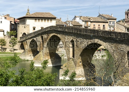 Puente la Reina Bridge over the Arga River. Puente la Reina, Navarra, Spain. XI Century. Romanesque. St. James Way. - stock photo