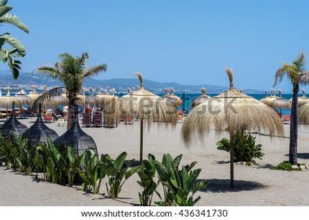 PUERTO BANUS ANDALUCIA/SPAIN - MAY 26 : Sun Umbrellas on the Beach at Puerto Banus Spain on May 26, 2016 - stock photo