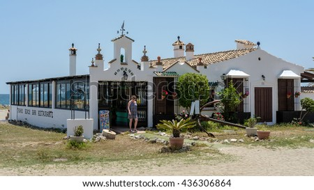 PUERTO BANUS ANDALUCIA/SPAIN - MAY 26 : Woman Leaving a Beach Restaurant in Puerto Banus Spain on May 26, 2016. Unidentified woman - stock photo
