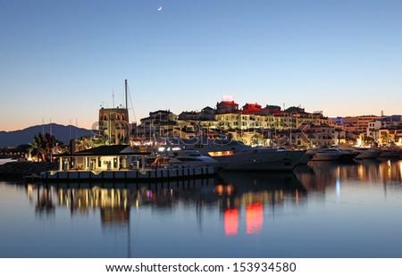 Puerto Banus at dusk, the marina of Marbella, Costa del Sol, Andalusia, Spain - stock photo