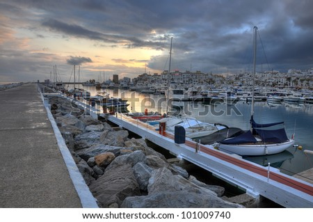 Puerto Banus surprised at sunset. Puerto Bano is an exclusivist port from Costa del Sol, surrounded by luxury restaurants and stores. - stock photo