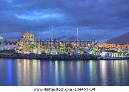 Puerto Banus, surprised before a storm.Puerto Banus  is a marina located in the area of Andalusia, to the southwest of Marbella, Spain on the Costa del Sol. - stock photo