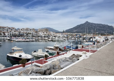 Puerto Banus surprised by day. Puerto Bano is an exclusivist port from Costa del Sol, surrounded by luxury restaurants and stores - stock photo