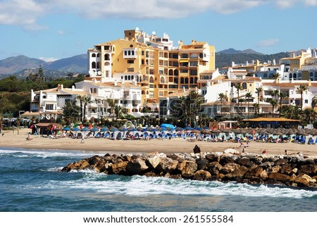 PUERTO CABOPINO, SPAIN - JUNE 7, 2009 - View of the beach with the breakwater in the foreground, Puerto Cabopino, Costa del Sol, Malaga Province, Andalusia, Spain, Western Europe, June 7, 2009. - stock photo