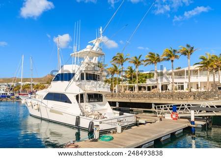 PUERTO CALERO MARINA, LANZAROTE ISLAND - JAN 17, 2015: luxury boat in port built in Caribbean style in Puerto Calero. Canary Islands are popular sailing destination. - stock photo