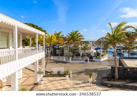 PUERTO CALERO MARINA, LANZAROTE ISLAND - JAN 17, 2015: traditional Caribbean style architecture of Puerto Calero marina. Yachting is a popular activity on Canary Islands.