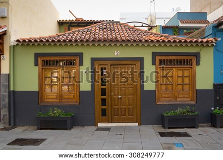 PUERTO DE LA CRUZ, TENERIFE, CANARY ISLANDS - JANUARY 14, 2014: Beautiful colorful buildings in old town of Puerto De La Cruz, one of the most popular touristic towns on Tenerife, Canary islands