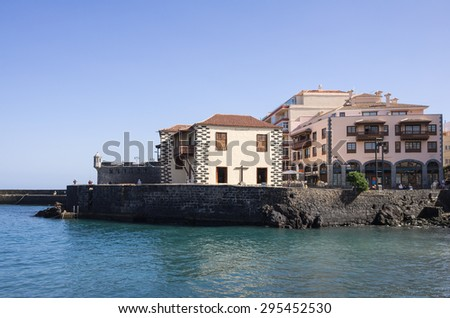 PUERTO DE LA CRUZ, TENERIFE, CANARY ISLANDS - JANUARY 11, 2014: Embankment in the old town of Puerto De La Cruz, one of the most popular touristic towns, Canary islands, Spain - stock photo