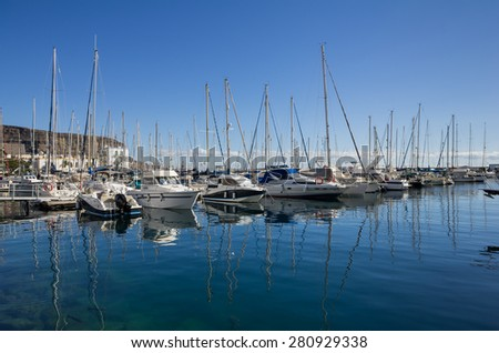 PUERTO DE MOGAN, GRAN CANARIA, CANARY ISLANDS - JANUARY 04, 2014: Yachts in harbor of Puerto de Mogan, a small fishing port and resort on Gran Canaria Island, Spain