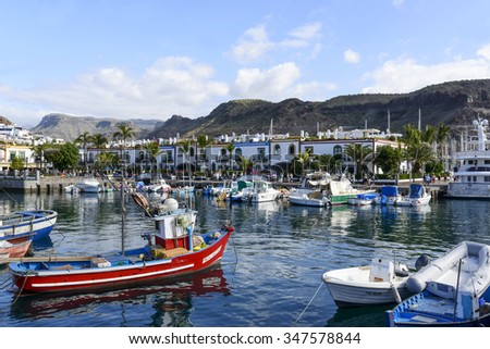 PUERTO DE MOGAN - NOVEMBER 27: View of the marina full of sailing boats in summer sunny day on 27 November 2015 in Puerto de Mogan, Gran Canaria Island.