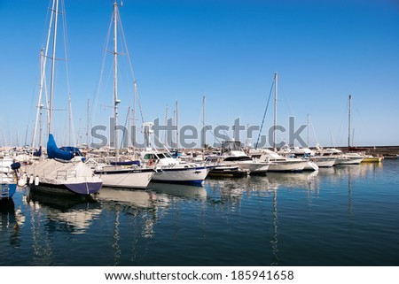 PUERTO DEL CARMEN, LANZAROTE/SPAIN - AUGUST 10 : Yachts and motor boats moored in the marina at Puerto del Carmen Lanzarote on August 10, 2005 - stock photo