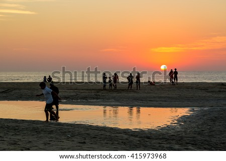 Puerto Escondido, Mexico - January 20th 2014 - Group of people enjoying a nice sunset in the beach of Puerto Escondido, Mexico.