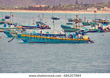 PUERTO LOPEZ, ECUADOR - CIRCA AUGUST 2016: Fishing fleet in the water by the fish market