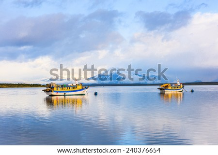 PUERTO NATALES, CHILE - NOV 6, 2014: A boat sailing near the Puerto Natales is the capital of  the province of Ultima Esperanza
