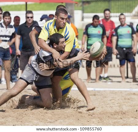 "PUERTO REAL, CADIZ - OCTOBER 17: Attack of ""Algeciras "", black, Against the team of ""Cadiz Rugby"" yellow in the tournament ""Villa de Puerto Real."" October 17, 2011 in Puerto Real, C�¡diz (Spain) - stock photo"