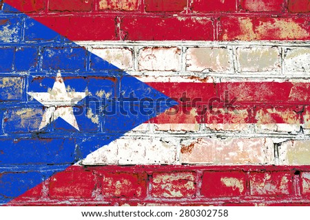 Puerto Rico flag painted on old brick wall texture background - stock photo