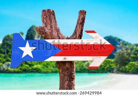 Puerto Rico Flag wooden sign with beach background - stock photo