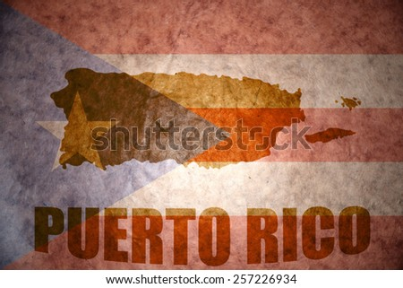 puerto rico map on a vintage puerto rican flag background - stock photo