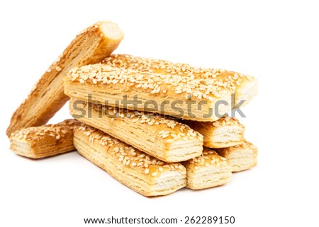 Puff biscuits with sesame seeds isolated on white background. - stock photo