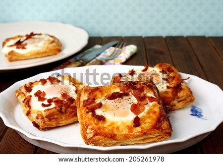 Puff pastry breakfast - egg, bacon and cheese  - stock photo