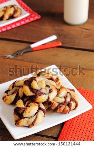 Puff pastry chocolate rolls - stock photo
