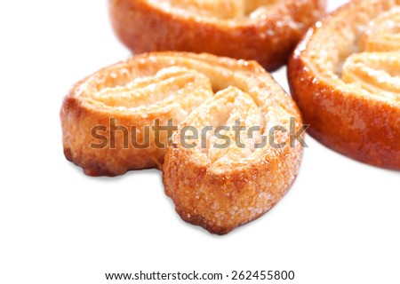 Puff pastry cookies (ears) with sugar on top close-up on white background - stock photo