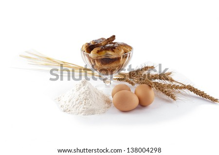 Puff pastry in piala, eggs, flour, spikelets on white background. - stock photo