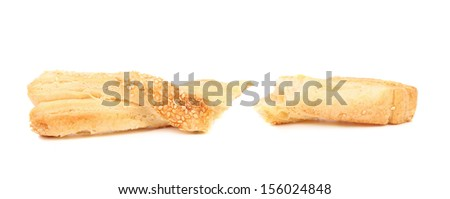 Puff pastry sticks with sesame seeds on white background