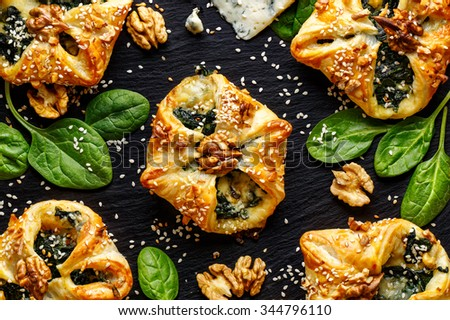Puff pastry stuffed with spinach and Gorgonzola cheese - stock photo
